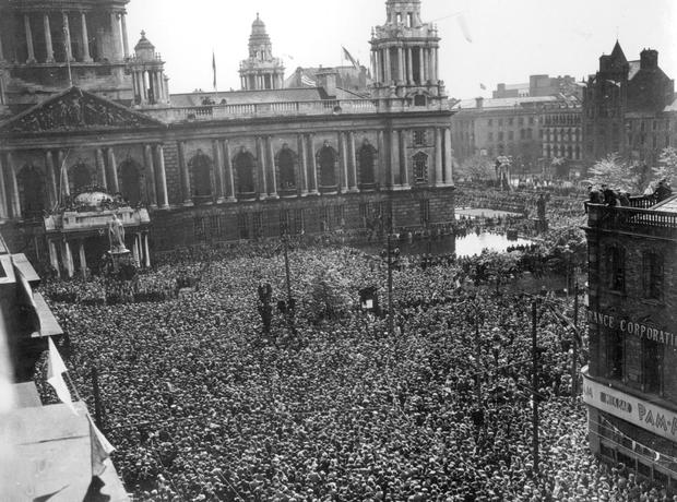 Victory at last: the massive crowds listening to Prime Minister Winston Churchill's broadcast at Belfast City Hall