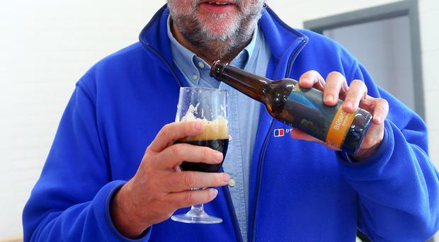 Heady brew: Ivan Little samples a taste of the beer