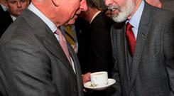 Symbolic gesture: Prince Charles and Gerry Adams shake hands over a cuppa