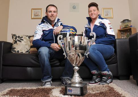 Biking triumph: Alastair and Tina Seeley with his NW200 trophy