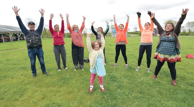 Full stretch: six-year-old Joy Quigley and friends enjoy a Laughter Yoga session at Tubby's Farm in Hillsborough