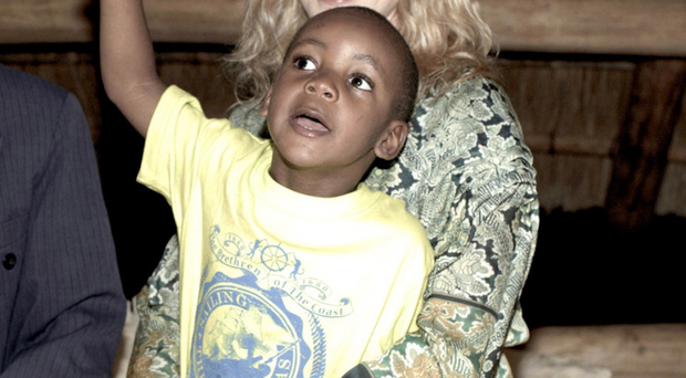 Motherly love: Madonna holding her adopted child David