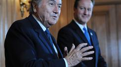 New heights: David Cameron (right) was full of praise for Sepp Blatter when they met in 2010