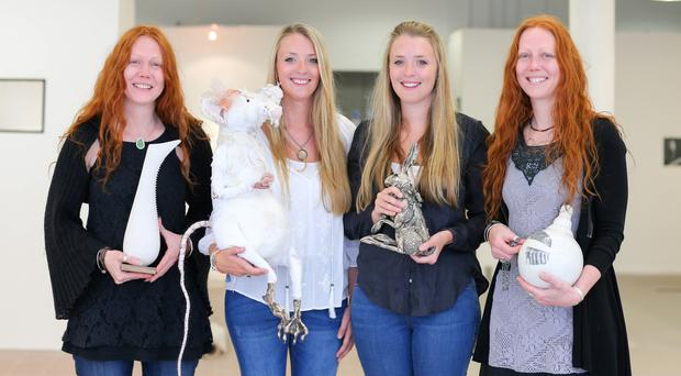 Seeing double: from left, identical twins Claire Gibson, Lauren Scott, Julie Scott and Karen Gibson