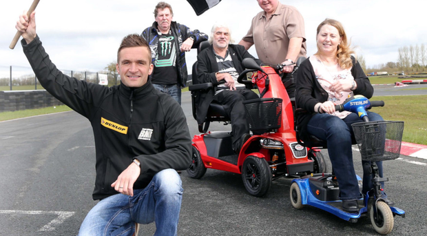 Chequered flag: Touring Car star Colin Turkington waves off Team Freeriders (from left) Noel Ingram, Sean Hurrell, Gerard Magennis and Pauline Ward.