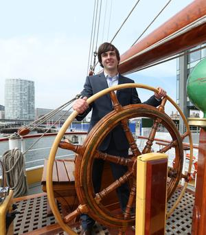 Quay to success: Neil O'Hagan of the Atlantic Youth Trust at the wheel of the Morgenster Den Helder 1919, ahead of the Tall Ships Festival