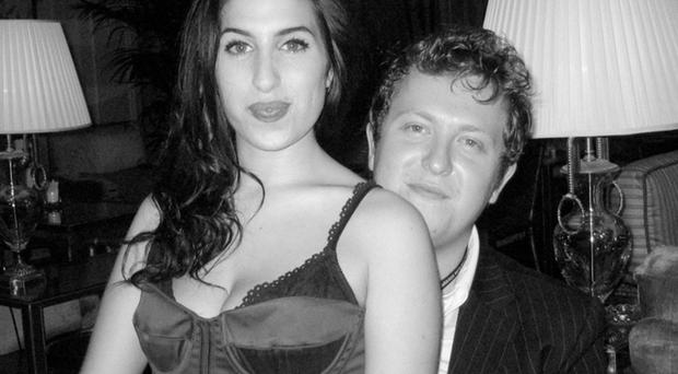 Better times: Amy Winehouse with manager Nick Shymansky who tried in vain to help her