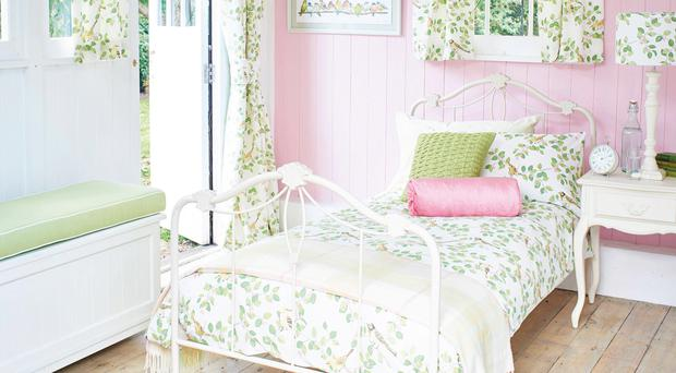 Aviary Garden bed set, £48, and Ready Made Curtains, from £47.50, Laura Ashley