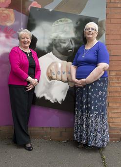 Building bridges: Jean Brown (right) and Renee Crawford at the peace wall between Suffolk and Lenadoon