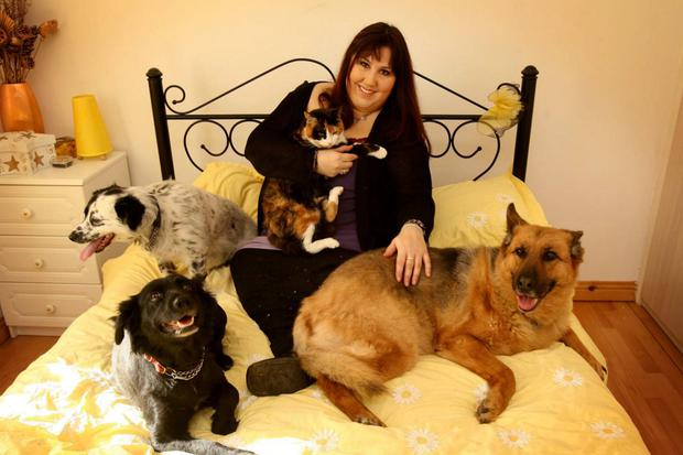 Pet pals: Andrea Smith with the animals that she loves so much