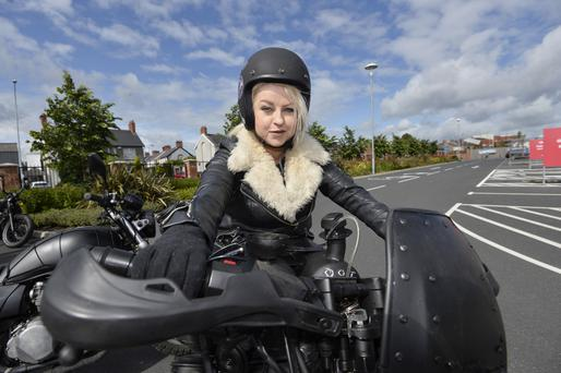 On her bike: Frances Burscough saddles up for the day with the Northern Ireland Rats