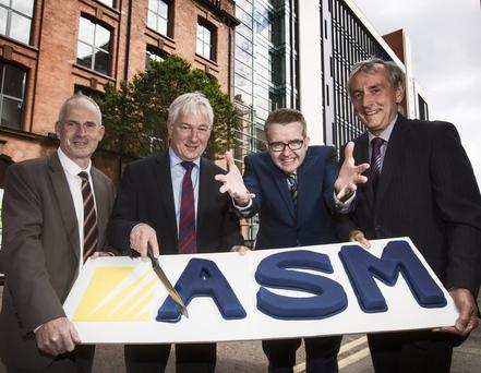 From left, Michael McAllister, Norman Adams, mentalist David Meade and Stephen Sproule celebrating ASM's 20th year in business