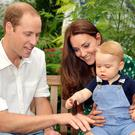 Public role: the Duke and Duchess of Cambridge with their son George