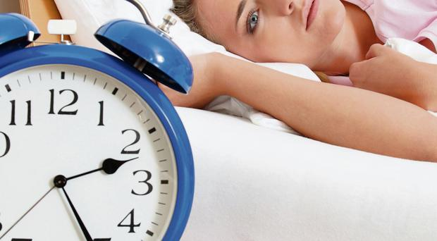 Wide awake: many of us find ourselves staring at the clock in the early hours