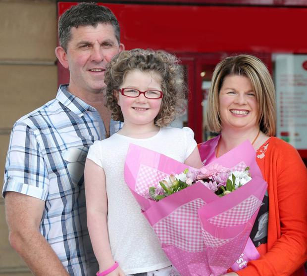Happy family: Rodney Brown with daughter Ellie Louise and wife Fiona