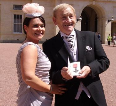 Proud moment: Brenda Shankey and her father Brendan Wilkinson with his MBE award