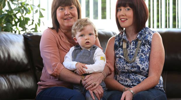 Family ties: left, Jackie Philips with her daughter Julie and grandson Oliver