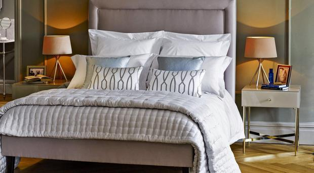 Bedstead £599, bedspread from £175, cushion fabric £35 per metre, table lamps £75 each, John Lewis
