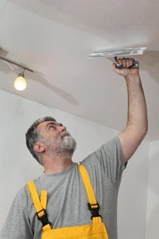 Messy job: getting ceiling work done can be very tricky