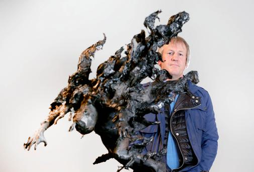 Stark reminder: artist Tim Shaw with Man on Fire, one of his sculptures in the new exhibition