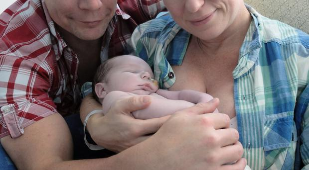 Campaign focus: Fiona Paddon with her husband Scott and son Edward who died days after being born