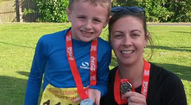 Medal glory: Lorraine Cartmill with her son Ryan