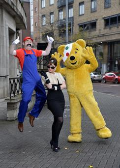 Star turns: Super Mario (aka Barra Best), Audrey Hepburn (aka Jo Scott) and Pudsey launch this year's BBC Children in Need Appeal