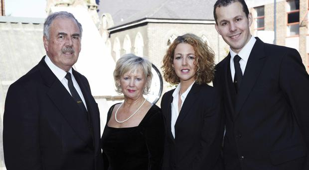 Family firm: Hugh Dougal and his wife Frances with daughter Cathy and son Hugh