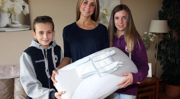 Home spun: Kerry, son Harry and daughter Amy with the Babocush
