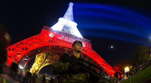 Terror aftermath: a French soldier at the Eiffel Tower