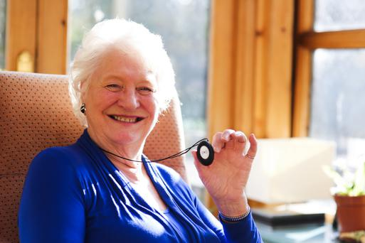 Safety first: Dame Mary Peters with her personal alarm