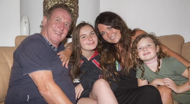 Happy family: Gerry and Deborah Armstrong with daughters, Caitlin and Marianna