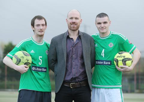 On the ball: Aidan Byrne (centre) from Street Soccer NI with Stephen Weldon (left) and Gerard Toner