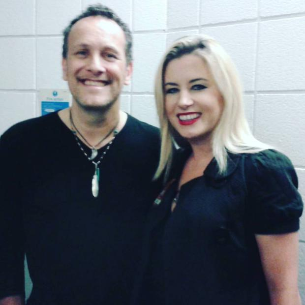 Family bond: author Emma Heatherington with Def Leppard guitarist Vivian Campbell backstage at the SSE Arena in Belfast