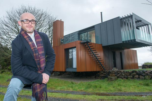 Grand Designs Architect Offers His Shipping Container Home For Auction To Hel