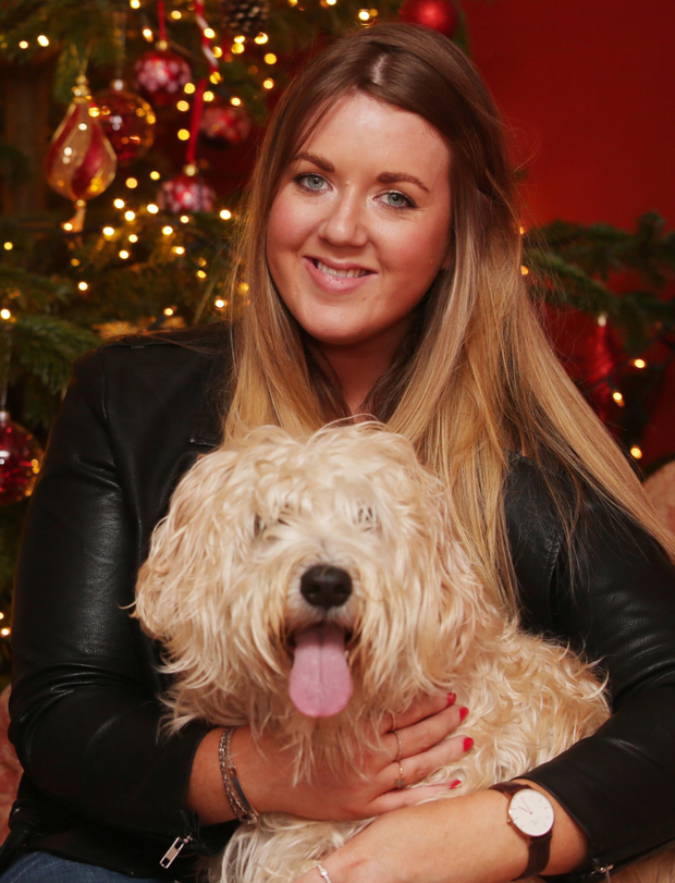 Surprise visitor: Megan Taylor, who lives and works in Canada, is back with her family and dog Holly in Carrickfergus
