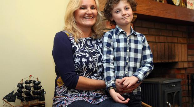 Busy mother: Grace McDonnell at home with her son Charlie