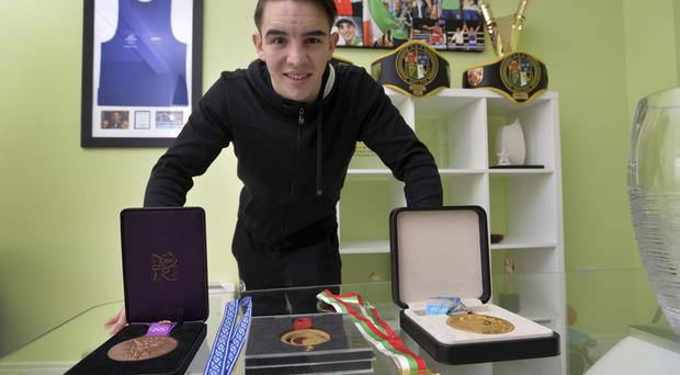 Trophy haul: Michael Conlan at his home with his boxing honours — his titles include gold at the World, gold and silver in European, gold in Commonwealth and bronze in the amateur championships