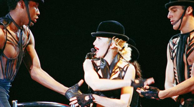 World stage: left, Madonna with her dancers on the Blonde Ambition tour at Wembley Stadium in 1990