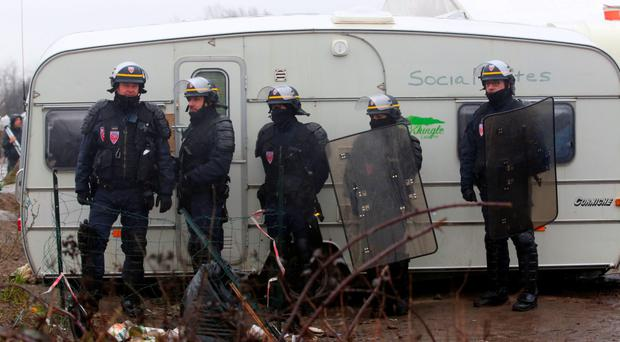 Welcoming committee: French police wore riot gear to clear refugees from a camp in Calais