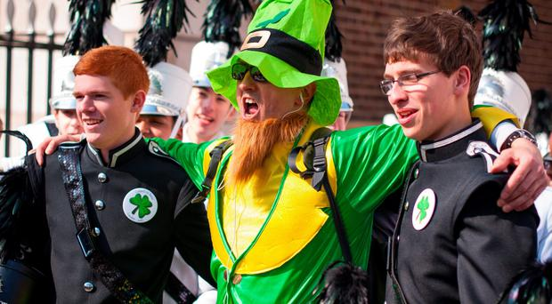 Going green: a man dressed as a leprechaun with Coppell High School Marching Band