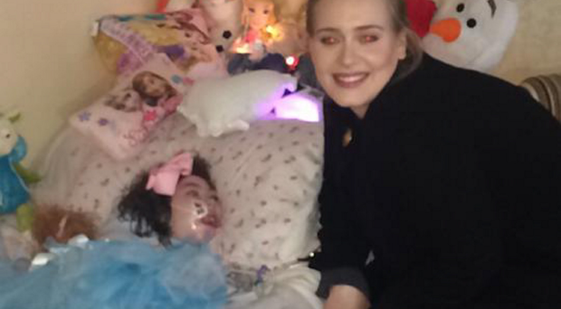 Adele sits at Rebecca's bedside in a surprise visit at the start of her latest tour