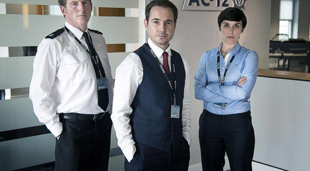 Adrian in the series with Martin Compston and Vicky McClure