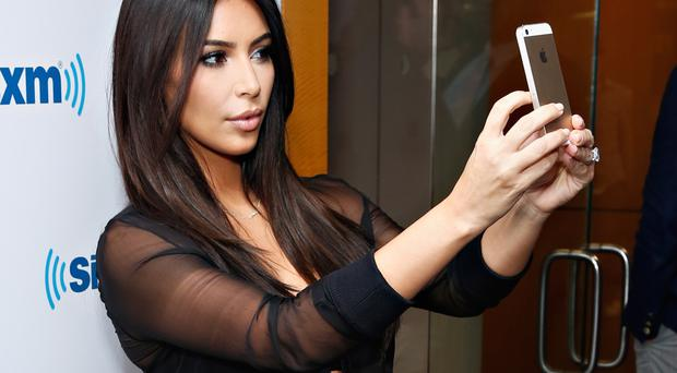 Snap shot: Kim Kardashian loves taking selfies