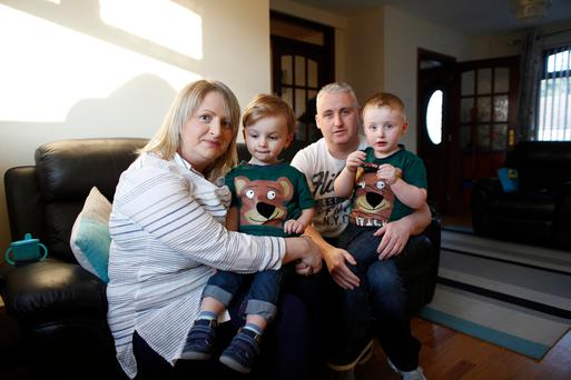 Family matters: teacher Christine Diamond with husband Neil and sons Rory (left) and Riley