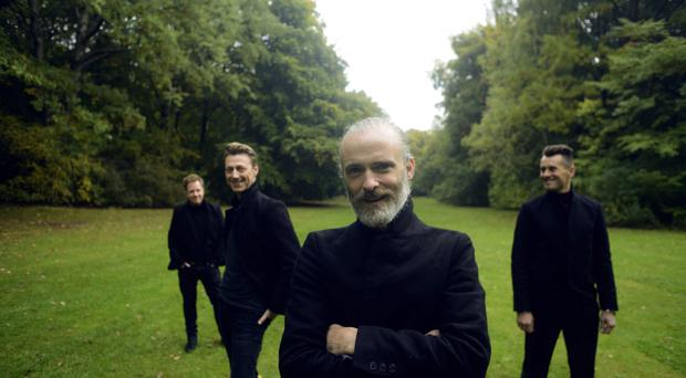 Good feeling: Fran Healy and his fellow rock star dads in Travis