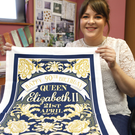 Finished product: Ulster Weavers designer Jennie Harvey who created the tea towel for the Queen's 90th birthday
