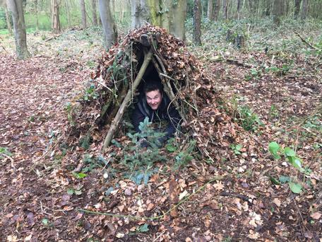 Declan Lawn in one of the shelters which the group learned to make