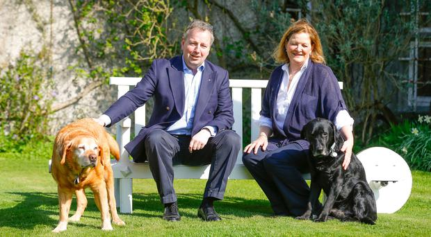 Shades of Downton: Danny Kinahan with his wife Anna and dogs Ollie and Odie at their Castle Upton home