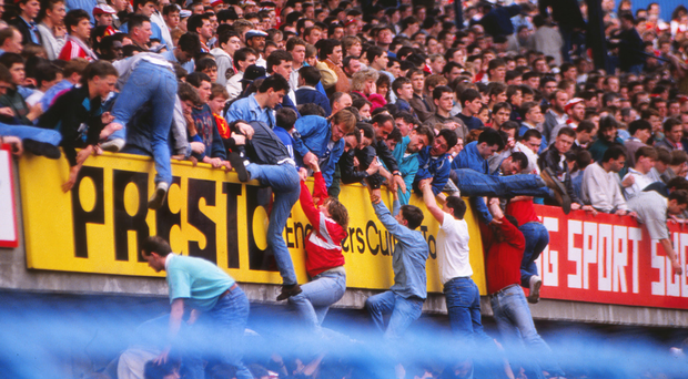 Fatal day: fans struggle to escape the crush at the Liverpool v Nottingham Forest FA Cup semi-final which led to the deaths of 96 people in 1989